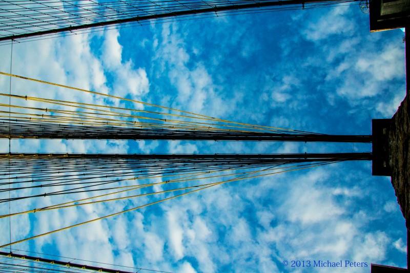 Brooklyn bridge blue skies. Looking up