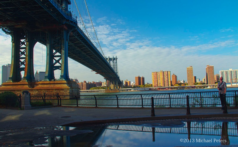 Underneath the Brooklyn Bridge with downtown Manhattan in sight