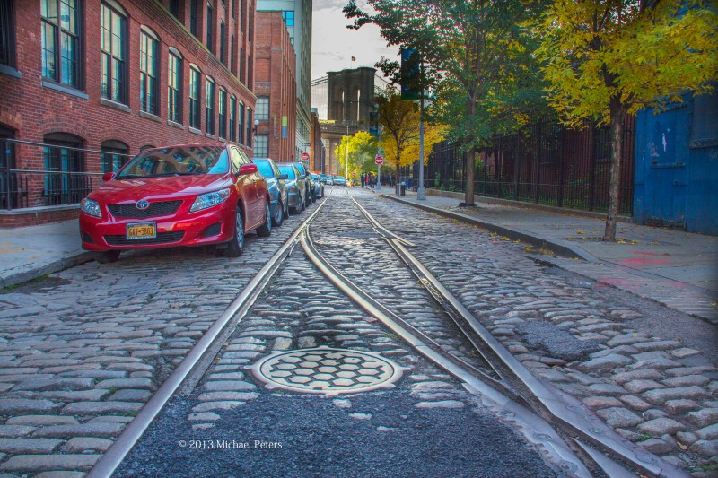 Viewing the Brooklyn Bridge for an old cobble stone roadway