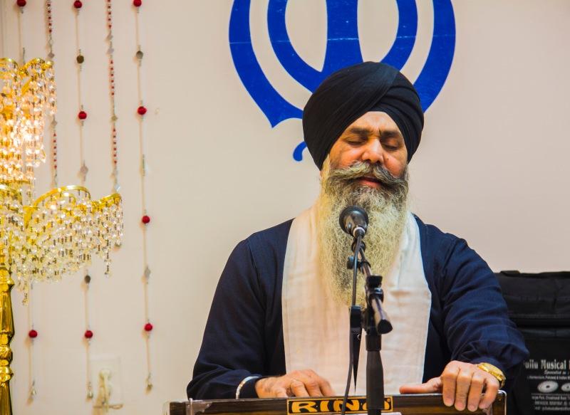 Sikh man on the harmonium