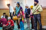 A family singing a Sikh hymns