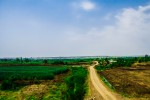 Viewing a dirt road in some small village