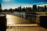 A walkway with the Manhattan skyline