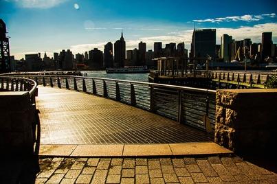 A walkway with the Manhattan skyline