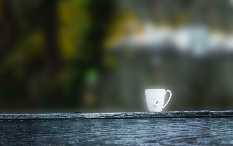 A cup on the deck railing