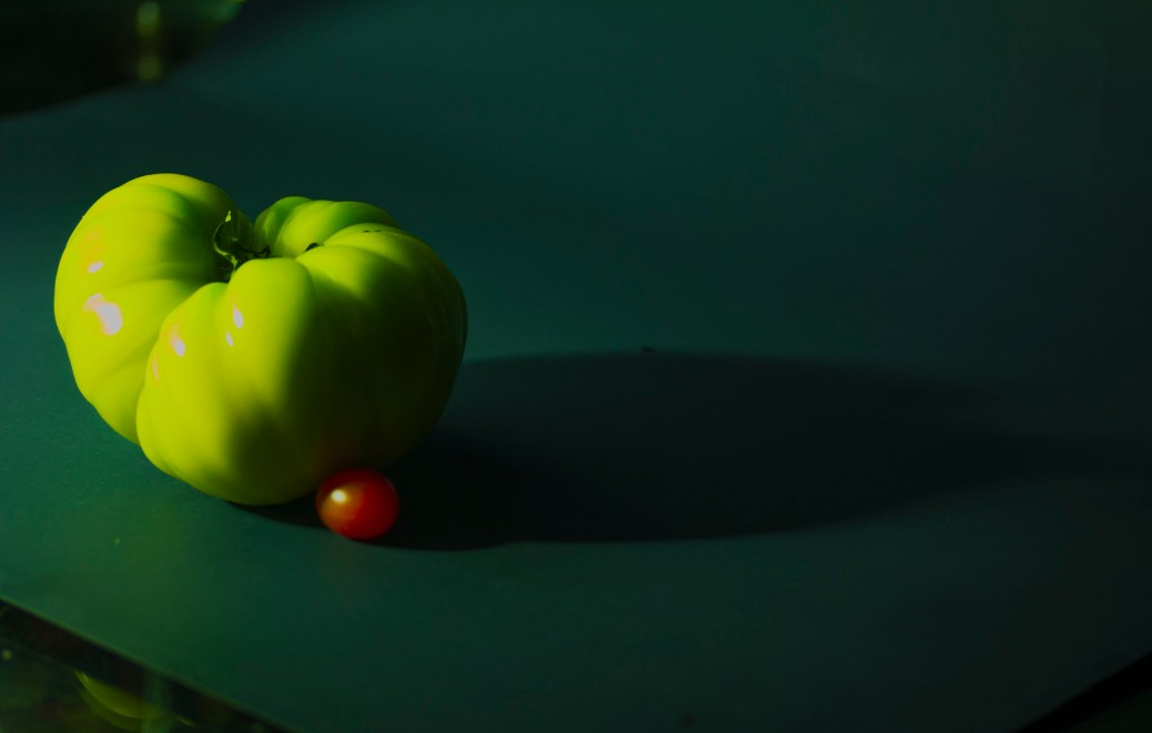 Green and small red tomato copy