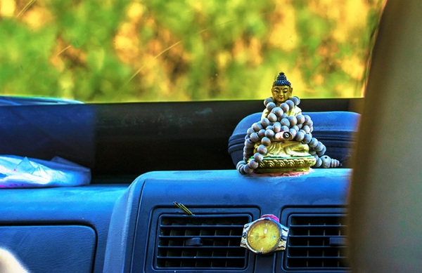Buddha on the dashboard